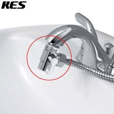 kitchen faucet diverter valve kohler how replace moen stuck spray mode sink sprayer pull out leaking