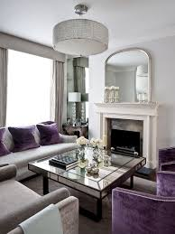 art deco living room with splashes of purple and mirrored coffee table design gemma