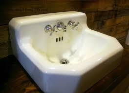 how to remove stains and clean an antique old cast iron american standard sink with vinegar