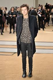 one direction s harry styles wears burberry navy trench coat and t shirt during london fashion week