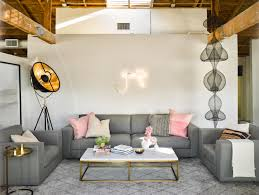 pthe entry lounge of the office features soft grey tones accented with pink and flashy neon