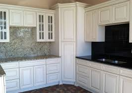 great painted kitchen cabinets white tile pattern ceramic kitchen backsplash black metal gas range top beautiful
