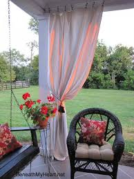 outdoor porch curtains. Handmade Outdoor Curtain Panels Pulled Back On Porch Corner With A Tieback Curtains