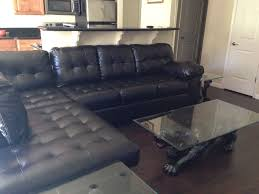 chocolate leather sectional with vine black panther coffee table set if 3