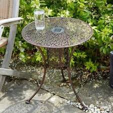 metal round filigree silhouette garden patio bistro table with solar led lights