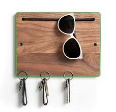 Find it HERE. I really loved the matte paint on wood, the simple shape and  the cord they used for hanging things like sunglasses.