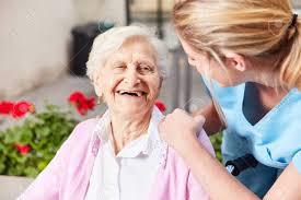 Geriatric Nursing Laughing Senior Woman And Caring Geriatric Nurse Together In