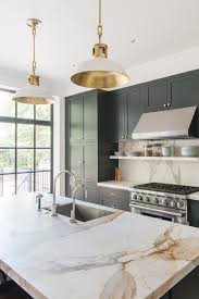 kitchen with marble countertop pendant lights green blue cabinets elizabeth roberts
