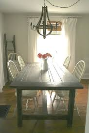 swag chandelier over dining table stupefy room chandeliers bronze home design ideas