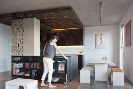 Most of the furniture in the apartment is multifunctional.They kept the raw  concrete ceiling as such because they liked how it looked and the fact that  it ...