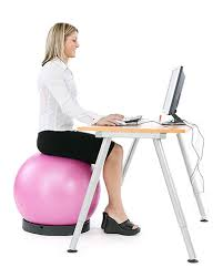 active sitting at the desk on a ball chair