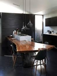 modern dining room with walnut slab dining table and tom dixon beat ls tom dixon pendants hang in dwell founder lara hedberg deam s home renovated by