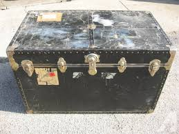 large antique black travel steamer trunk coffee table