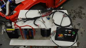 mounfield motorsports 2jz powered r34 skyline wiring harness laid out on a table the harness is modular allowing for easy removal and service a far cry from where it was at when the vehicle was