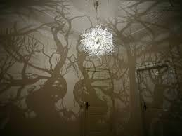 Shadow Lamps A Chandelier That Projects Tree Shadows Colossal