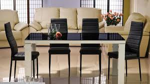 Beautiful dining furniture, black glass top table and upholstered chairs