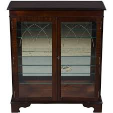 a stunning english bookcase in mahogany wood with amazing etched glass doors