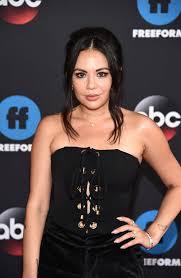 janel parrish portra mona vanderwaal on pretty little liars the actress is pictured attending the disney abc freeform upfront on may 15