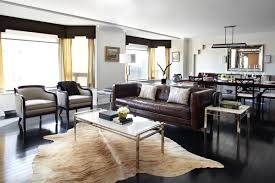 Living Room With Brown Leather Sofa Masculine Living Room With Cowhide Rug Dark Brown Leather Sofa