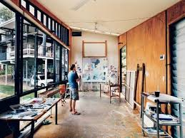 In his detached painting studio, Dunlop considers a work in progress. The  building is oriented east-west to avoid direct sunlight, and the long, ...