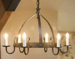 black metal chandelier mitre 6 light round wrought iron chandelier in natural black with ivory candle
