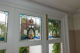 timber bifold doors in finchley internal view of stained glass panels