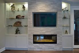 custom wall unit dimplex blf50 set into wall of erthcoverings silver fox stone with custom cabinetry on the sides