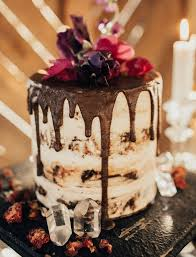 beautiful wedding cake. a semi-naked cake dripping with thick chocolate is enough to make our mouths water beautiful wedding s