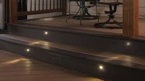 millennium recessed led deck lights from dekor are installed in stair risers to illuminate the tread