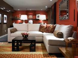 Small Basement Ideas with Comfortable Sofa close Red Wall Paint and Black  Table. Let's create a mini family room.
