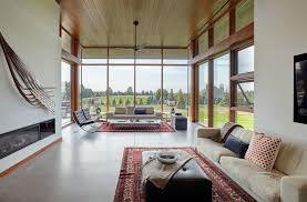 living room area rugs. Another View Of The Living Room Showcasing Its White Couch, Red Rug And Walls. Photo Credit: Maciek LinowskiTrevor McIvor Architect Inc Area Rugs
