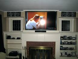 smlf install flat screen tv above stone fireplace installing wall mount on rock interior wooden bookcase design