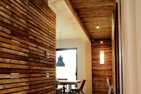 reclaimed lath wall. the long wooden corridor leads to a (photo: samuel archambault) reclaimed lath wall s