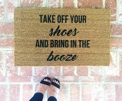 Take off your shoes and bring in the booze-door mat-door