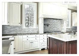 gray and white backsplash light grey white cabinets dark floors gray tile light grey kitchen light