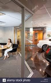 showroom office. Woman Sitting In Car Showroom Office