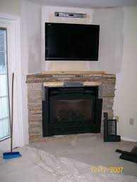 decorate your home with a corner fireplace mantel for elegant tv above gas fireplace