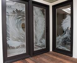 a door panel and a window of 3 4 lo iron safety laminated glass in a marvin entry system the beach house is located on the sand near santa cruz ca