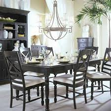 rustic pics of dining rooms with chandelier black cabinet black table with candle and glass with black chairs image