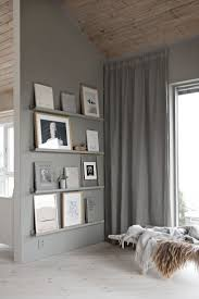 Paint your Mosslanda picture ledge to match your walls for a stylish IKEA  hack. Also featured is the Ivar cabinet and Frosta stool