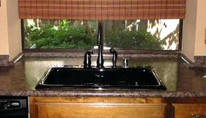 witching dark brown color granite kitchen laminate features black cast iron sink and wooden cabinets