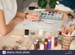 Sketching Clothing Female Clothing Designer Sketching With Brush At Workplace Stock