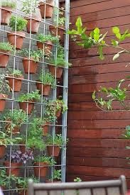double sided hanging vertical garden planter for annuals and vertical garden ideas