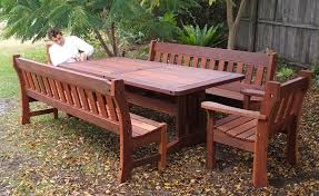 large outdoor recycled timber table and dining bench