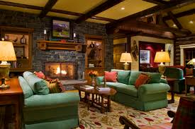 great fabric green sofas and cushions as well log wood coffee table also stacked stone fireplace panel in rustic living room decors rustic living rooms with fireplaces d63 rustic