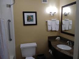 a bathroom at hilton garden inn tulsa airport