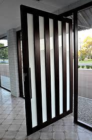 framed pivot doors above images to enlarge