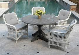 7703 ham 50 round teak dining table with four chairs detail