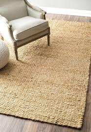 beige ikea accent chair with beige sisal rug on cozy dark pergo flooring and 8x10 sisal