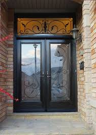 woodgrain exterior doors woodgrain doors front entry doors wood grain fiberglass doors iron art glass design front door with iron art transom installed by